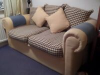 Sofa Bed - metal framed with sprung mattress