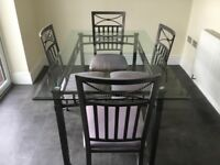 Glass top dining table and 4 matching chairs.