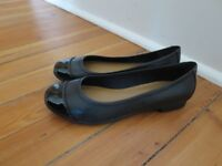 Clarks ladies black, flat shoes. Size 4.5. Never worn.