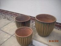 Three ceramic plant pots