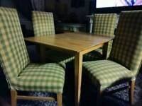 Extended dining table and 4 high back chairs