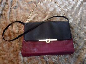 Beautiful maroon and black handbag