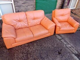 Orange leather sofa and swivel chair - delivery available.