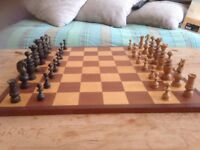 Solid wood, hand turned chess board.