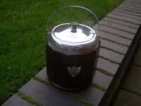 A very attractive multi faceted oak tea caddyt