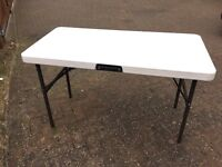 Folding Table from the Lifetime Range. 122cm x 64cm - Legs fold under - carry strap - Used but good