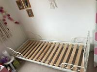 Child's cream / white metal frame 'extendable' bed, wood slat base and mattress (Ikea)