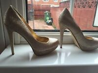 Gold Heels only worn for 2 hours almost brand new size 8 selling due to being to high for me