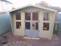 FS: Wooden garden shed with double doors and glass windows (10ft x 8ft)