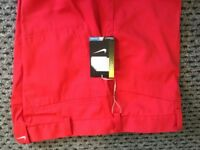 Nike Dri-fit golf trousers, red brand new with tags, size 34 x 34.