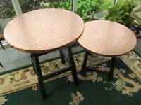 Two copper top oak legged tables one large one small.