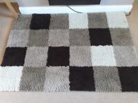 Brown mink and cream check rug. Shaggy style. Aporox 6ft x 3ft