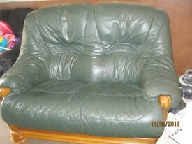 Green faux leather sofa with wood effect for sale