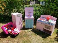 Wooden oven, fridge, washing machine utensils and play food.