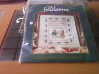 New counted cross stitch kit.Picture is of a sampler with children playing in a cart ,alphabet etc.