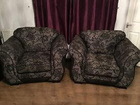 Black and grey two seater sofa and two armchairs