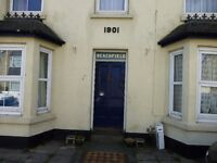 LONG ROCK, near Penzance - comfortable two bedroom flat, gas central heating and off road parking