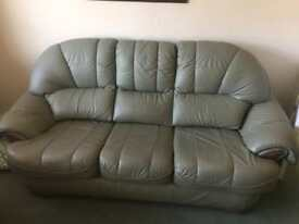 Re upholstered Leather reclining Sofa and two matching reclining Chairs