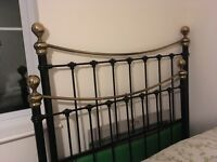 Bedknobs and broomsticks standard double bed, black painted steel with brass knobs, good condition.