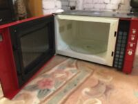 """Red Sanyo microwave, VGC. H11"""" W19"""" D12.5"""""""