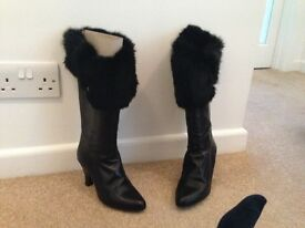 Women's calf length leather boots. Never worn.