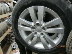 SET OF 4 USED 235/60R17 BRIDGESTONE WINTER TIRES ON ALLOY RIMS FOR A 3 SERIES BMW