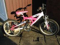 GIRLS BIKE, MAGNA SPARKLER, IT IS IN EXCELLENT CONDITION, It has front and rear suspension.