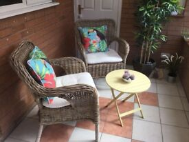 Two wicker conservatory chairs