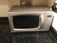 Nearly new 700W microwave for sale
