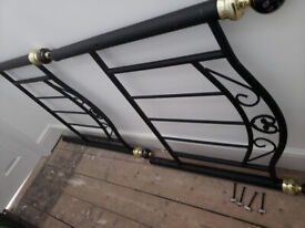 Black metal single bed base . Attractive head and footboard