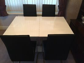Dining Table and Chairs, White with 4 Black Chairs, Six Seater Pull Out.