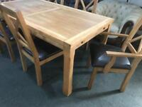 As new large solid oak dinning Table with 6 chairs