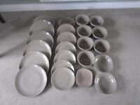 BEIGE POTTERY PLATES AND BOWLS