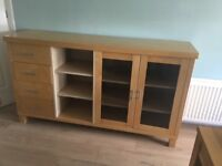 Wooden sideboard with 4 drawers and glass displayin good condition