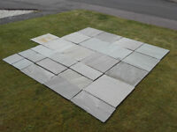 Marshalls Indian grey sandstone paving slabs. 6 sq.m plus about 4sq.m off cuts. 22mm thick.