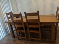 Solid oak dining table with chairs and bench