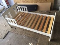 Child's bed. Wooden frame and slats.