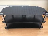 A very good condition glass tv stand