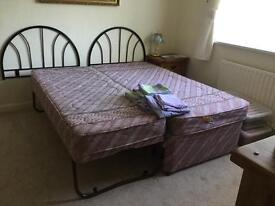Two single beds with mattresses