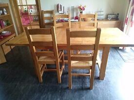 Solid oak extending table and 8 chairs