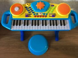 Child's musical keyboard and stool