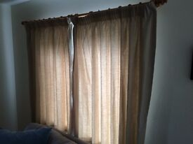 Two matching pairs of cream curtains with rails and fittings