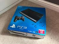 PS3 PlayStation boxed and in excellent condition with 18 games