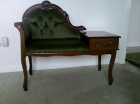 Seated telephone table with a draw