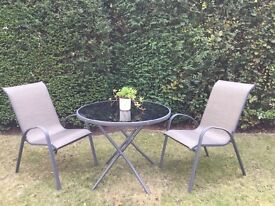 Homebase Patio set , as new! Glass topped, fold flat table , 4 stackable chairs and parasol and base