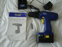 CORDLESS DRILL /SCREWDRIVER 12V WITH CHARGER. DRILL BIT , BOX AND BOOKLET