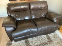 Brown leather reclining sofa and footstool