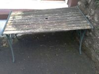 Cast iron Garden Table wood top. & a pair of bench ends