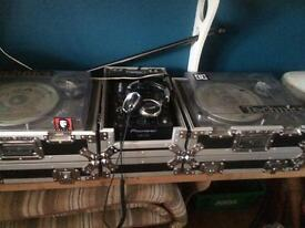 Pair of technics sl1200 with ortofon stylus needles . Pionner Djm 400 mixer road-ready flightcase