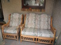 Two seater cane sofa and one armchair, suitable for conservatory or house